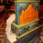 "Old barrel organ set to play ""Bonne Anniversaire,"" or Happy Birthday"